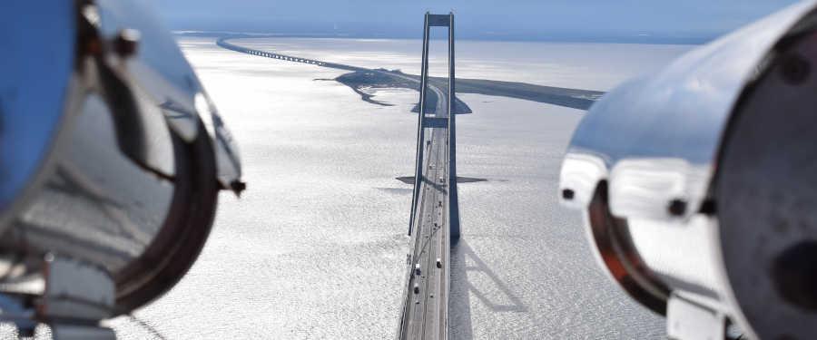 Surveillance cameras looking at a bridge.
